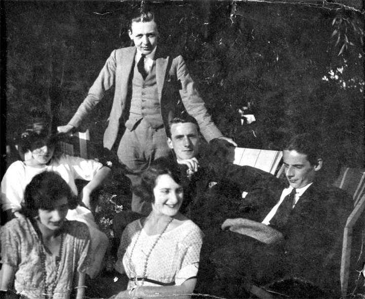 Photograph of Edward (standing), together with colleagues, at a Stoll Theatres office party in 1921.