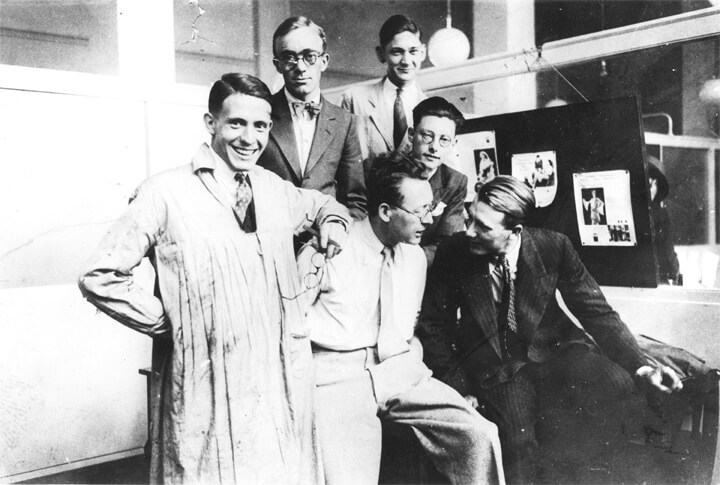 Edward (centre sitting on table) with the Lintas design and layout team at Unilever House in 1934.