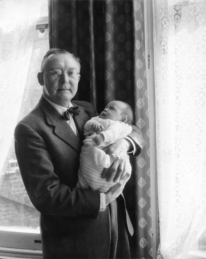 Edward holding his son Robert in 1959.